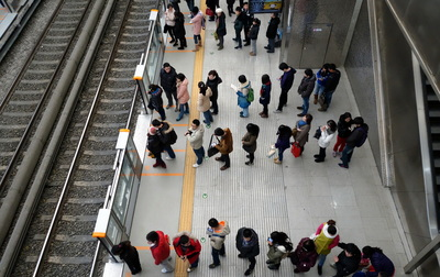 queue to get on a train in japan